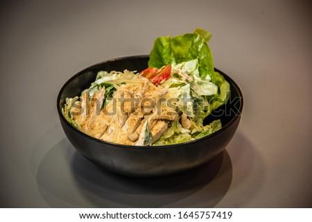 Caesar salad , chicken salad , salad with bread