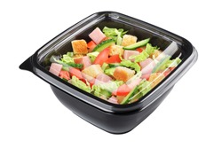 Caesar salad in plastic disposable take out container isolated on white background with clipping path