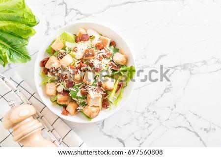 caesar salad on table - Healthy food style #697560808