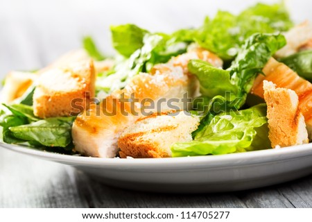 Caesar salad on wooden table