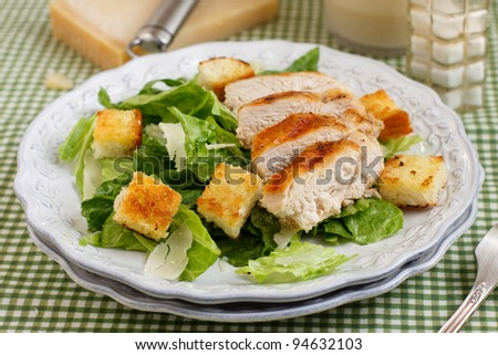 Caesar salad with grilled chicken stock photo