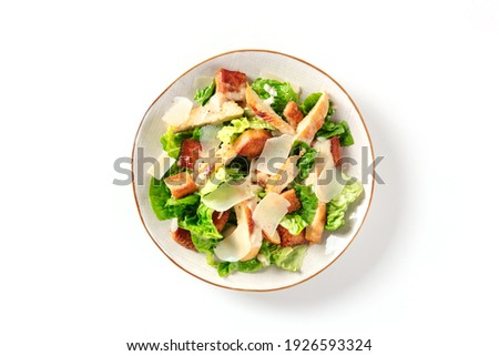 Caesar salad with grilled chicken meat, romaine and Parmesan, shot from the top on a white background Photo stock ©