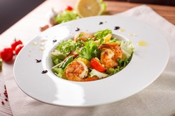 Caesar salad with shrimps and iceberg leaves