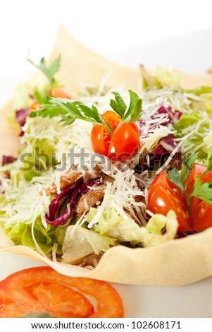 Caesar Salad with Sliced Meat, Salad Leaf, Cherry Tomato and Parmesan Cheese. Garnished with Tomato Slice and Pastry
