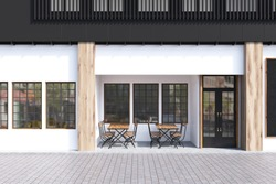 Cafe exterior with white walls and two wooden tables with chairs standing near a door. 3d rendering