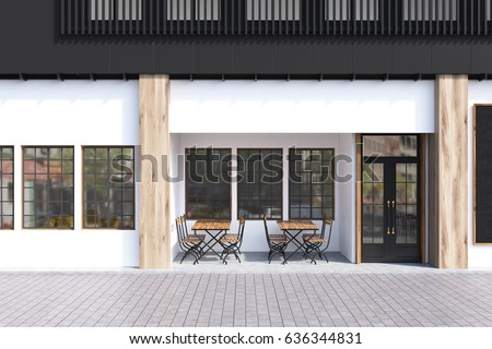 Cafe exterior with white walls and two wooden tables with chairs standing near a door. 3d rendering #636344831