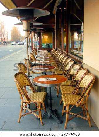cafe in paris in  street cities with a gas heater