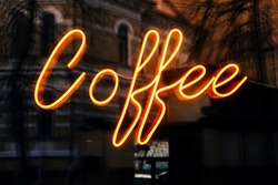 Cafe neon glowing sign with coffee lettering.