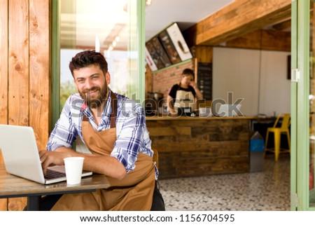 Cafe owner in cafe