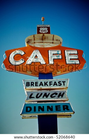 Cafe sign along historic Route 66 in Arizona. Vintage Processing.