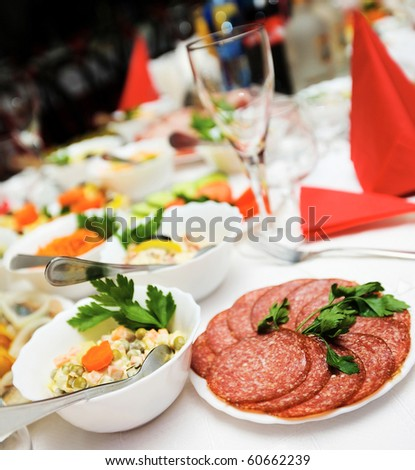 Cafe table with plenty of food on it - stock photo