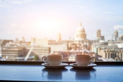 cafe with view of London, two cups of coffee and St Paul cathedral