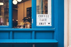 Cafe with window offering take away delicious coffee and food