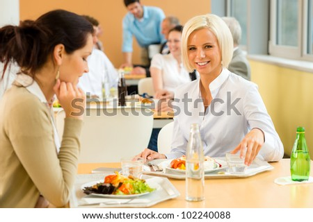 Cafeteria lunch young business woman eat salad at office canteen