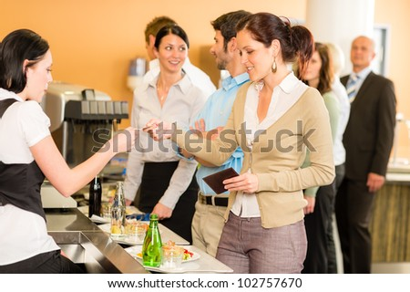 Cafeteria woman pay by credit card cashier food on serving tray