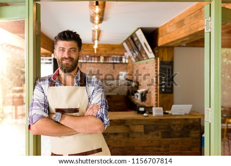 Cafeteria worker posing in cafe