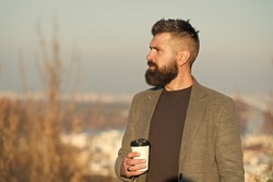 Caffeine addicted. Hipster hold cup with caffeine energy drink. Bearded man recharge with hot caffeine drink on crispy outdoor. Morning is better with coffee caffeine.