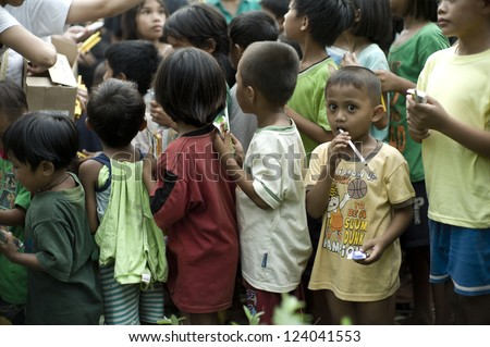 CAGAYAN DE ORO PHILIPPINES DEC 20 unidentified children in Mindanao which was hit by storm Sendong smile when they line up for relief on December 20 2011 in Cagayan de Oro Philippines
