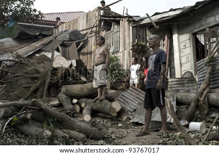 CAGAYAN DE ORO, PHILIPPINES - DECEMBER 20: The victims in hardest hit areas in northern Mindanao left by tropical storm Sendong on December 20, 2011 in Cagayan de Oro, Philippines.