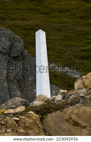 Cairn marking the international border between Canada and the United States. White Pass, north of Skagway, Alaska.