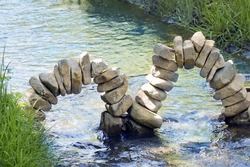 cairns, arches of stones in the water. Nature