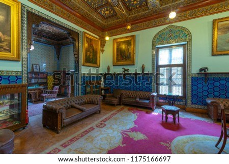 Cairo, Egypt - August 26 2018: Manial Palace of Prince Mohammed Ali. Living room at the residence building with Turkish floral blue pattern ceramic tiles, vintage furniture, European style paintings #1175166697