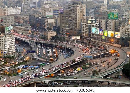 CAIRO, EGYPT - FEBRUAR 25: Cairo traffic jam on February 25, 2010. Transportation collapse at main intersection in Cairo, Egypt. - stock photo