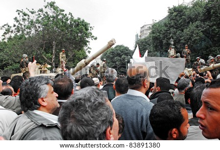 CAIRO - FEB 1: Egyptian anti-government protesters pass by an army checkpoint to enter Tahrir square. Cairo, Feb 1, 2011