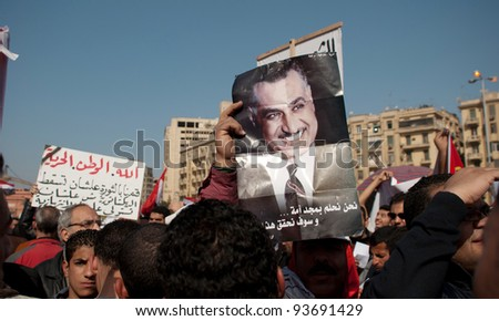 CAIRO – JAN 25: Nasserist party supporters hold signs and pictures of Gamal Abdel Nasser during first anniversary of Egypt's uprising in Tahrir Square in Cairo, Egypt on January 25, 2012