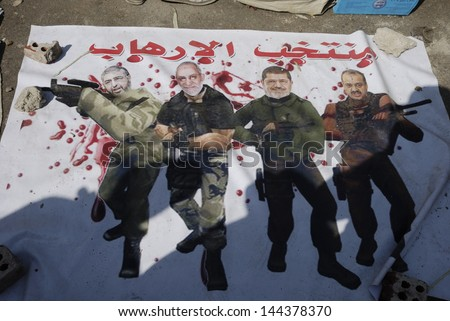 CAIRO JUNE 30 Banner shows Khayrat el-Shater Mohamed Badie Muhammad Morsi and Mohamed el-Beltagy as terrorists in Tahrir Square on June 30 2013 in Cairo Egypt