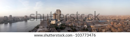 CAIRO - MARCH 8: Panorama of Cairo, Egypt and the Nile with Fairmont Nile City Hotel on March 8, 2010. The 34-story towers were completed in 2001/2.