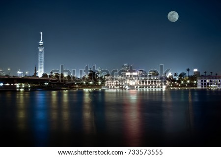 Cairo skyline at night with full moon in the scene  #733573555