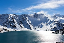 Cajon del Maipo, it´s a amazing place nearby Santiago. Worth a visit in winter, a dam at the foot of the Andes;