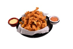 cajun chicken and sauces in the bucket. fast food fries with cajun chicken. White background