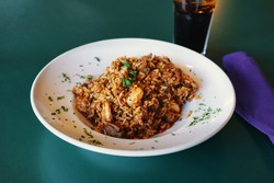Cajun Jambalaya, American dish. Typical and authentic Louisiana Cajun Creole cuisine. Stew consisting of chicken, andouille and shrimp with Bayou seasoning and white rice.