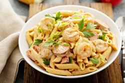 Cajun shrimp and sausage penne pasta in a bowl