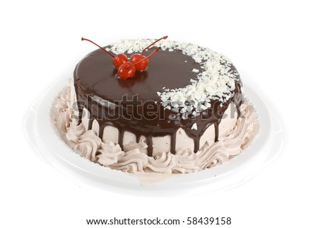 cake closeup with cherry isolated on a white