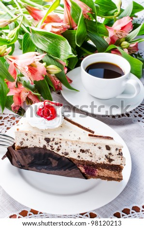 Cake coffe and flowers on table cloth
