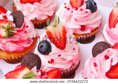 Cake in a box. Strawberry cake in a paper box. Background for advertising a confectionery. DIY cake. Strawberry and blueberry cake.