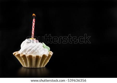 cake on a black background closeup #539636356