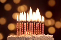 Cake shot on a bokeh background with candles.