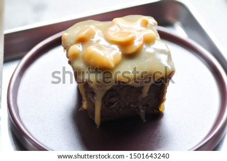 cake, toffy cake or chocolate cake with caramel and cashew nut topping