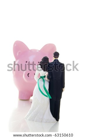 stock photo caketopper wedding couple and piggy bank money troubles