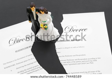 stock photo caketopper wedding couple on a torn divorce document