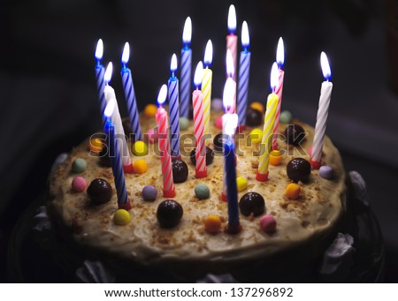 Cake with candles with cream and meringue