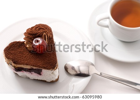 Cake with cherry and cup of tea