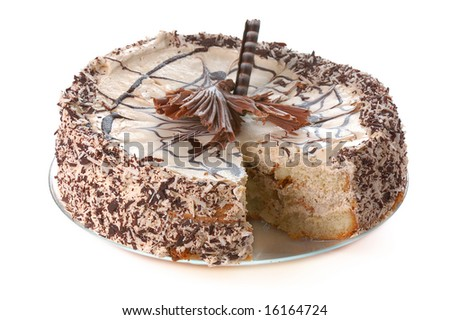 cake with chocolate  and  coconut crumbs lacking one piece isolated on white