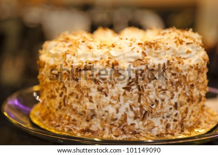 Cake with coconut sprinkled frosting on top