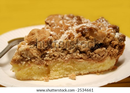 Cake with crumb topping on paper plate