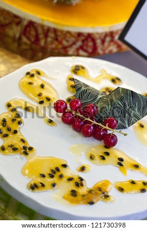 Cake with exotic fruit and gooseberries